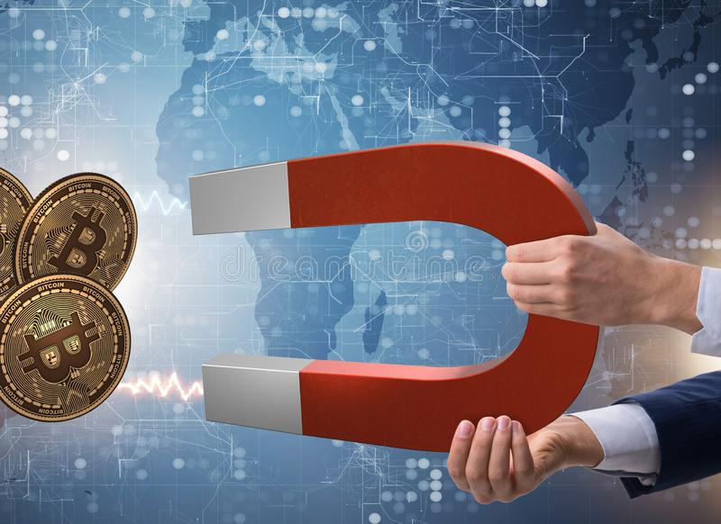 Businessman mining bitcoins with horseshoe magnet. The businessman mining bitcoins with horseshoe magnet stock photography