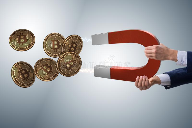 The businessman mining bitcoins with horseshoe magnet. Businessman mining bitcoins with horseshoe magnet stock photography