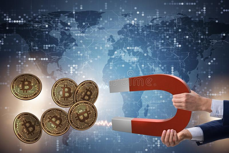 The businessman mining bitcoins with horseshoe magnet. Businessman mining bitcoins with horseshoe magnet stock photo