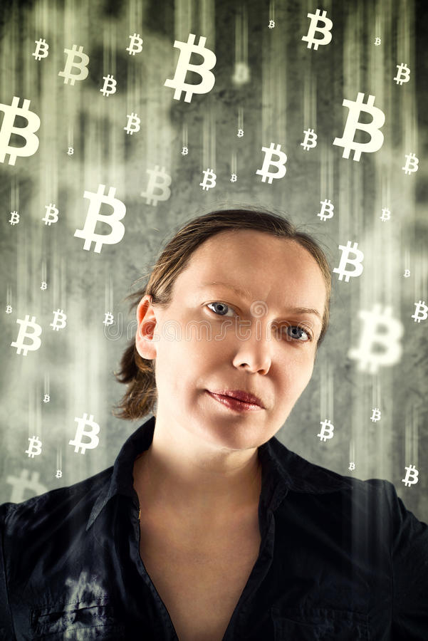 CoBusinesswoman collecting bitcoins. Businesswoman collecting bitcoins. Virtual money conceptual image royalty free stock photos