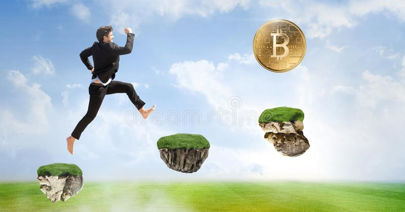 Businessman collecting bitcoins jumping on game platforms in sky. Digital composite of Businessman collecting bitcoins jumping on game platforms in sky stock image